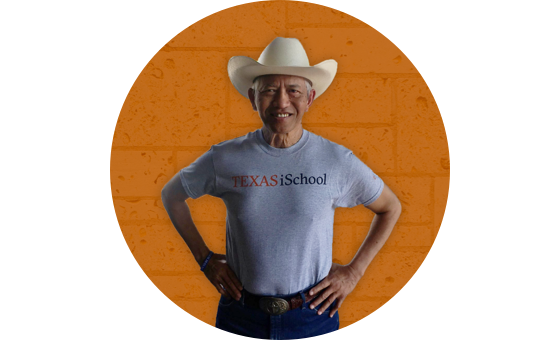 Ambassador Sichan Siv wearing an iSchool tshirt and cowboy hat