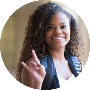 a black girl with a confident smile and victory hand gesture