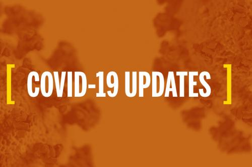 Text that reads Covid-19 Updates on a background of the coronavirus with an orange overlay