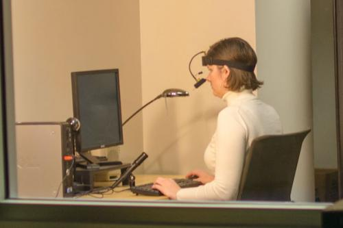 Researcher observing remote eye tracking research subject in the iSchool's Information eXperience lab