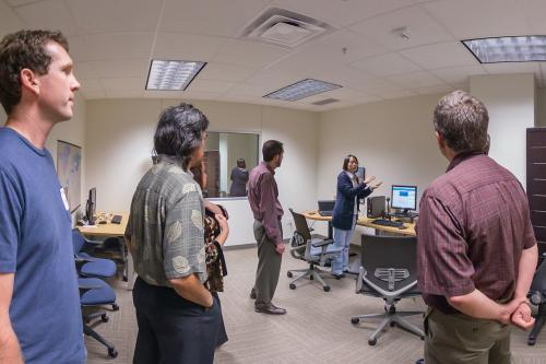 Faculty members offer visitors a tour of the Information eXperience lab