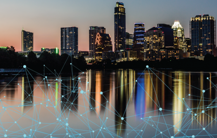 Austin skyline during evening overlaid with a graphic of a network web