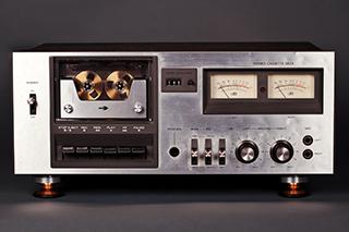 A silver cassette deck on dark grey background