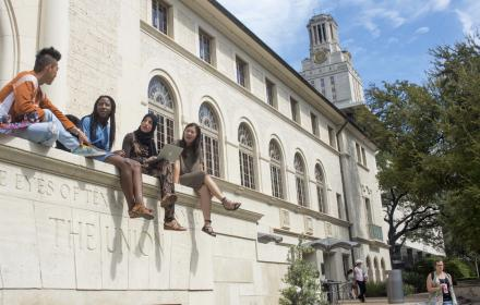 Students sitting on a ledge at the University of Texas Union Building