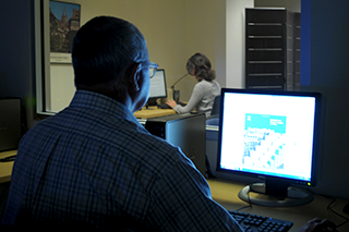 A researcher observing a research subject in the iSchool's Information eXperience Lab