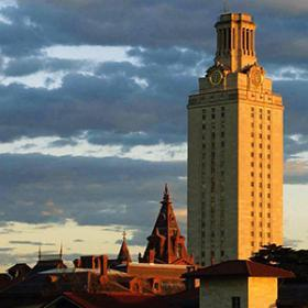 University of Texas tower lit up by warm light of sunset